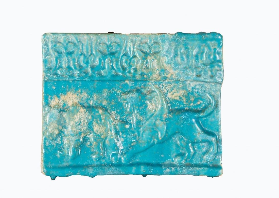 Arte Islamica  A Kashan turquoise glazed pottery tile