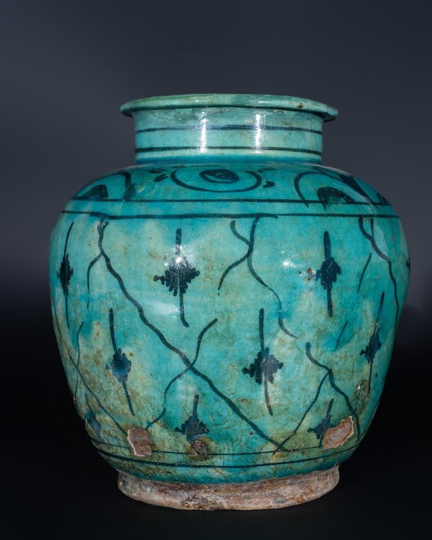 Arte Islamica  A Qajar turquoise glazed pottery vase
