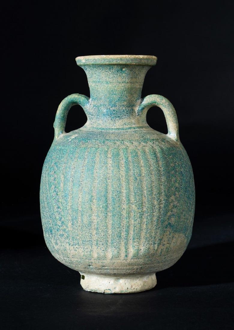 Arte Islamica  A Raqqa turquoise glazed pottery jug