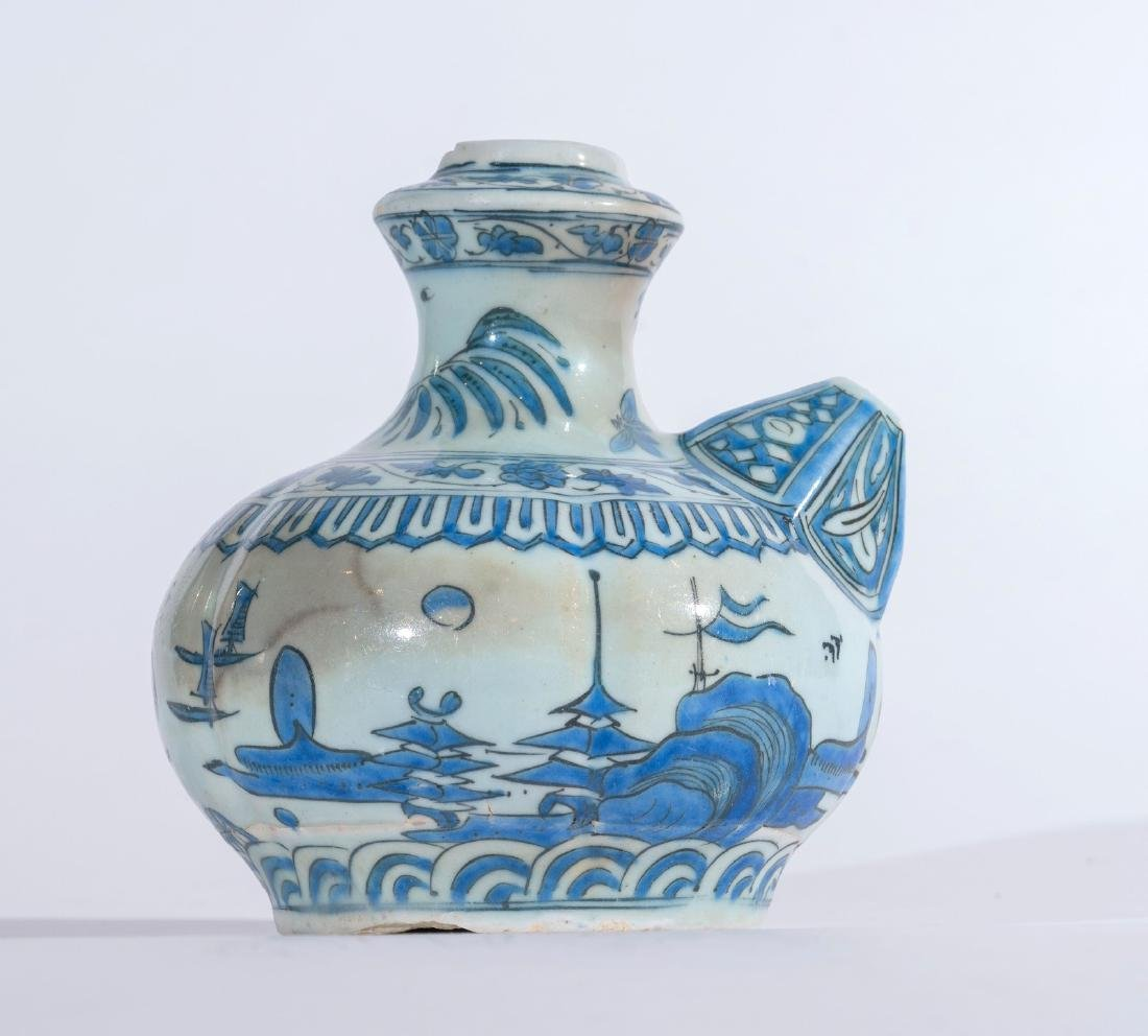 Arte Islamica  A blue and white pottery kendi bearing a