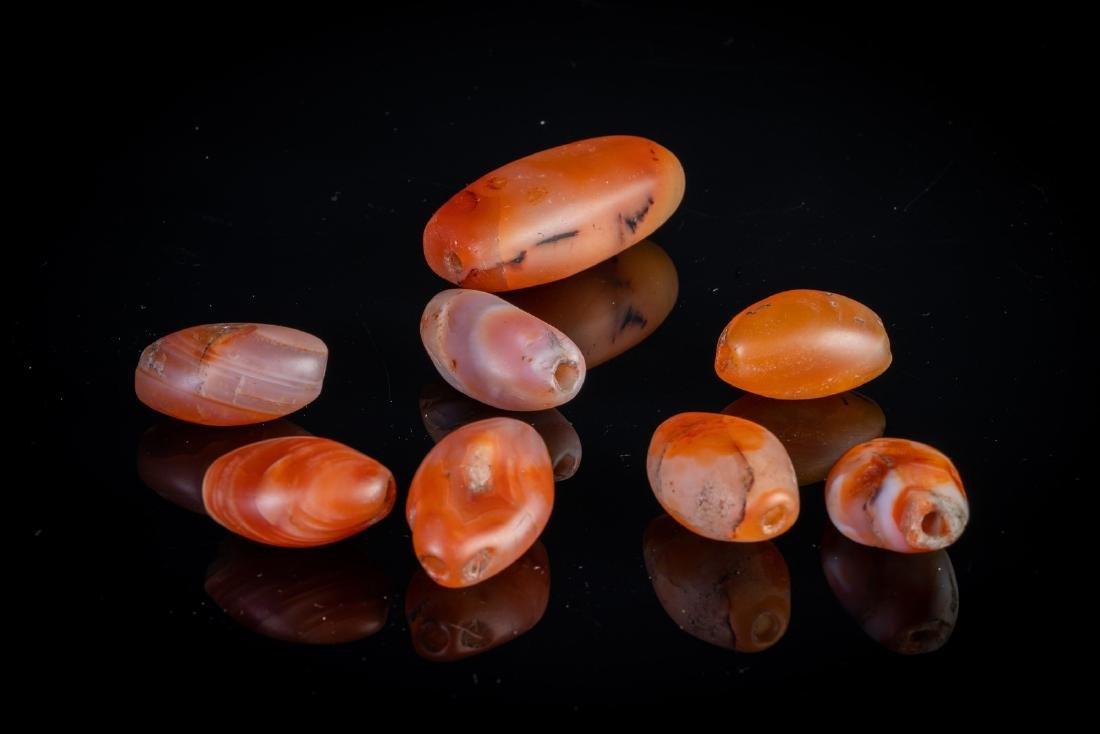 Arte Himalayana  A group of eight carnelian beads .