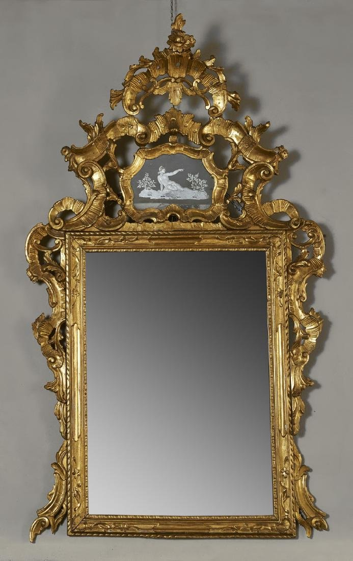 MANIFATTURA VENEZIANA  Gilded and carved wood mirror.