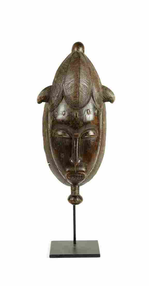 Arte africana  Portrait mblo mask, BauleIvory Coast.