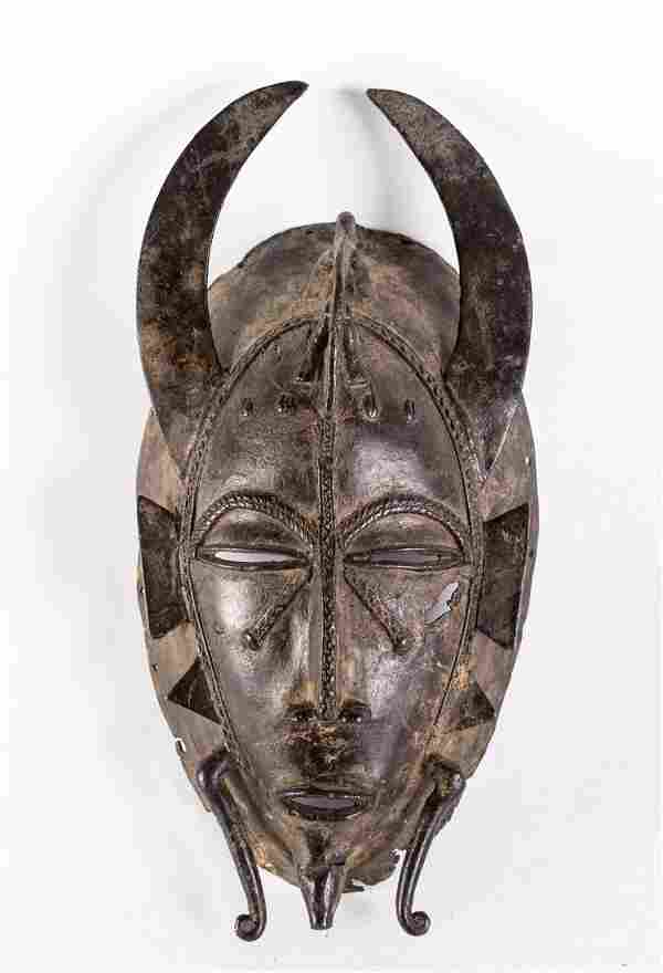 Arte africana A Kpelie mask, SenufoIvory Coast.