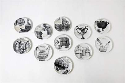 PIERO FORNASETTI Set of eleven plates for Martini &