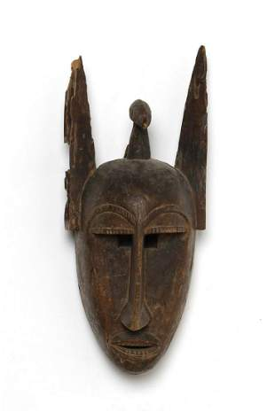 Arte africana  A anthropomorphic Baule maskIvory Coast.