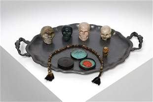Wunderkammer  Tray with small memento mori skulls and