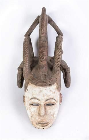 Arte africana Agbogho mmwo helmet mask, IgboNigeria.