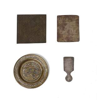 Arte Islamica A group of three talismanic metal