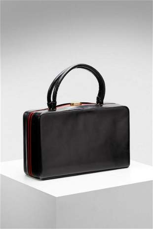 GUCCI Black leather bag with red interior.
