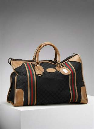GUCCI Monogram canvas and leather travel bag.