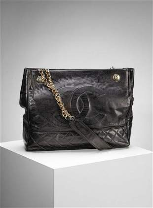 CHANEL Black leather bag with two handles.