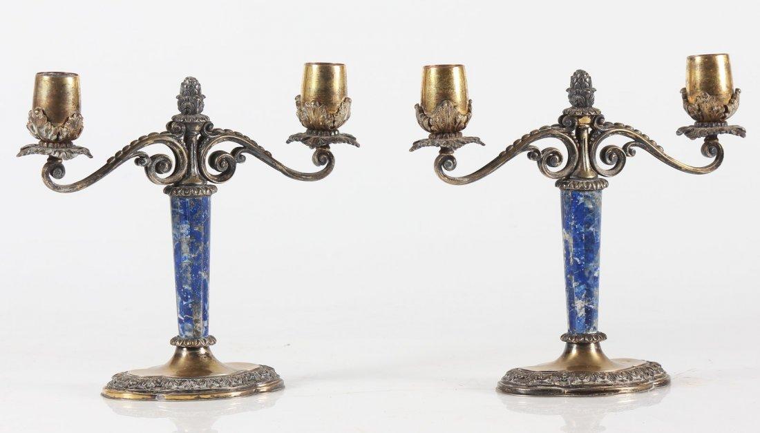 MANIFATTURA ITALIANA Coppia di candelabri in argento a