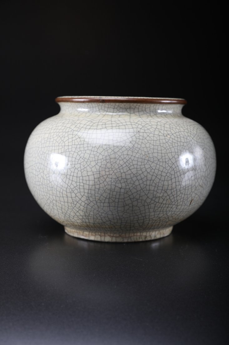 Arte Cinese Glazed globular base with metal mouth rim