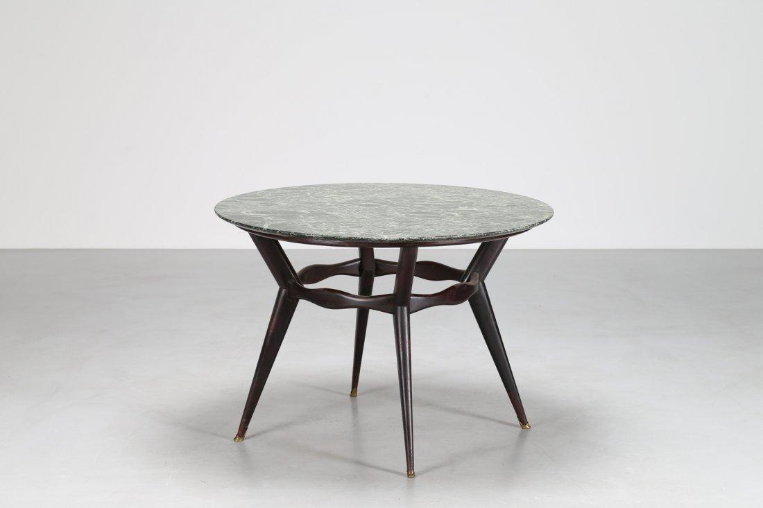 OSVALDO BORSANI Tavolo rotondo  in legno ebanizzato