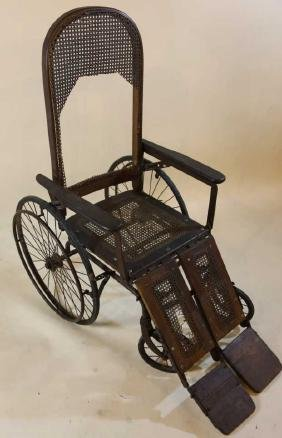 ANTIQUE CANED WHEEL CHAIR