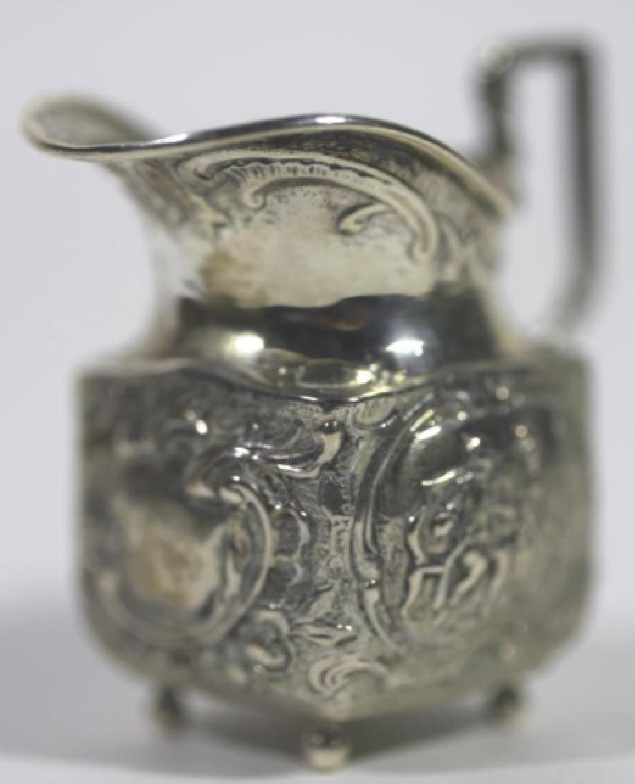 STERLING SILVER PETITE HAND CHASED FOOTED PITCHER - 4