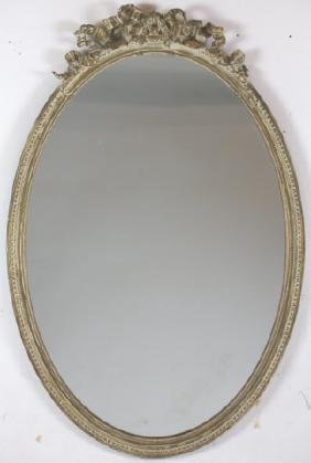 FRENCH ANTIQUE PARCEL GILT OVAL MIRROR