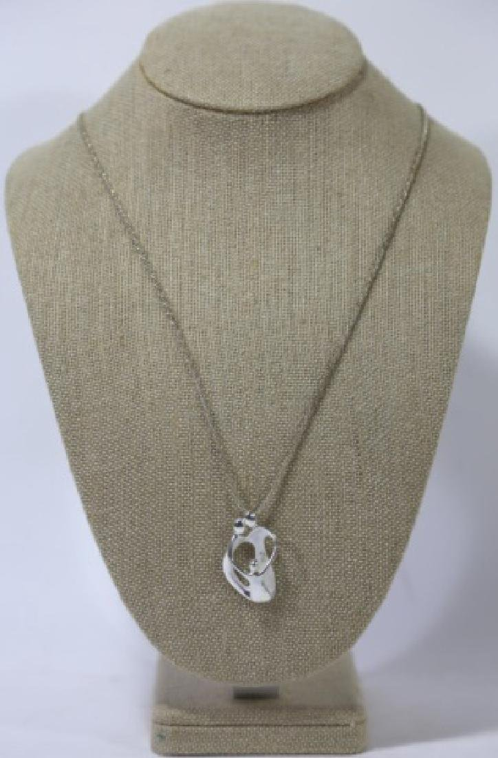 MODERN STERLING SILVER PENDANT ON CHAIN