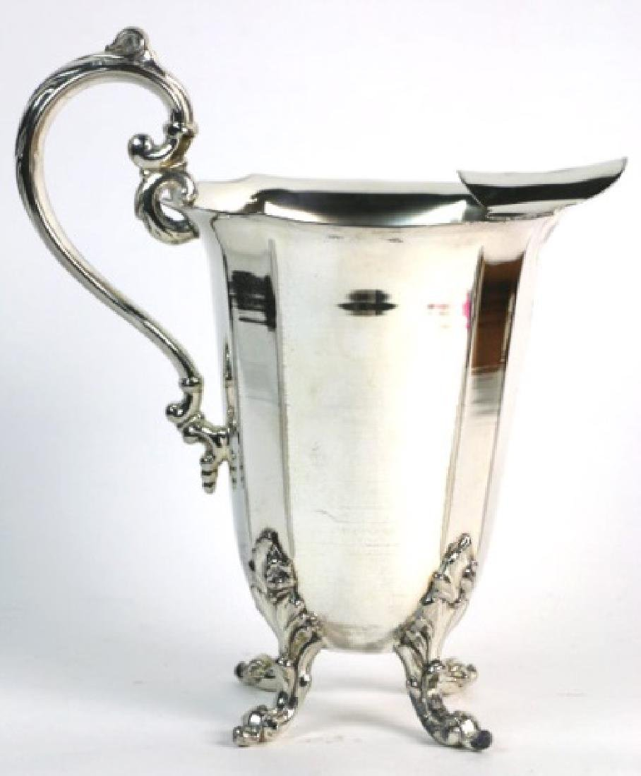 ENGLISH FOOTED SILVER WATER PITCHER