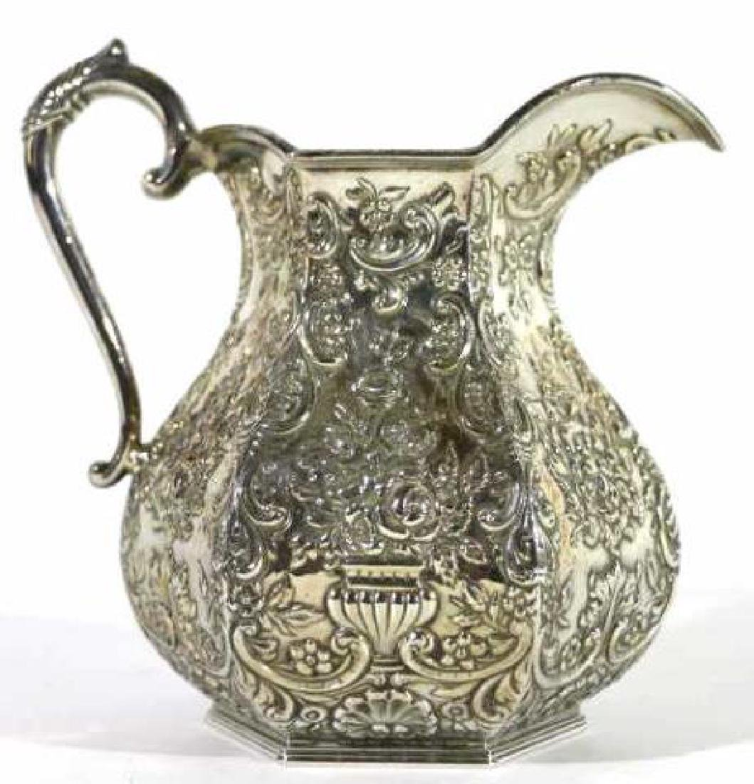 HAND CHASED SILVER PITCHER