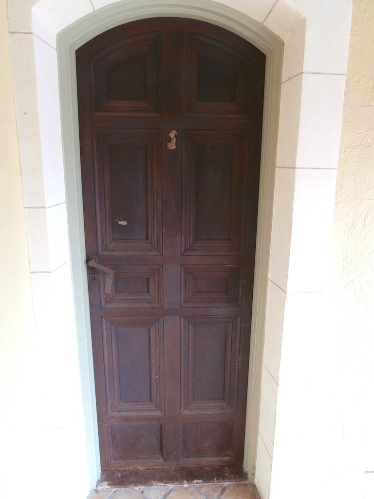 7: ANTIQUE DOOR LEADING TO THE POOL BATH: