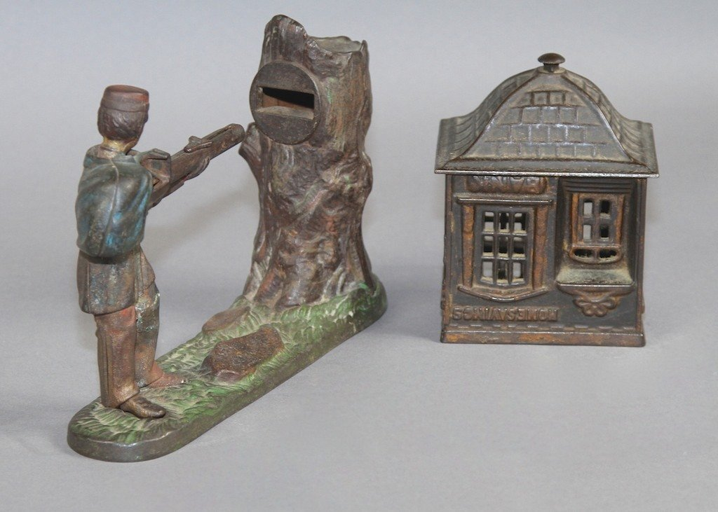 12: TWO CAST IRON COIN BANKS: