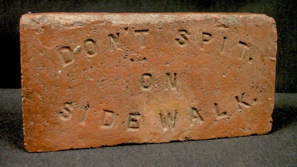 "686: ""DON'T SPIT ON SIDEWALK"" BRICK:"