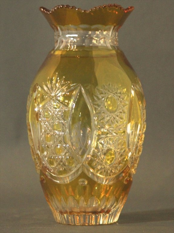 CUT TO CLEAR AMBER VASE:
