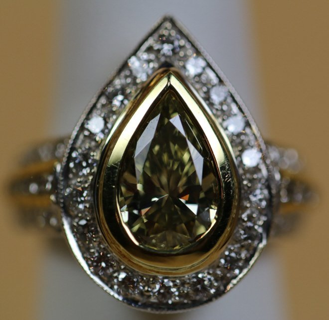 3 CT. PEAR SHAPE FANCY YELLOW BROWN / 2CT WHITE BR