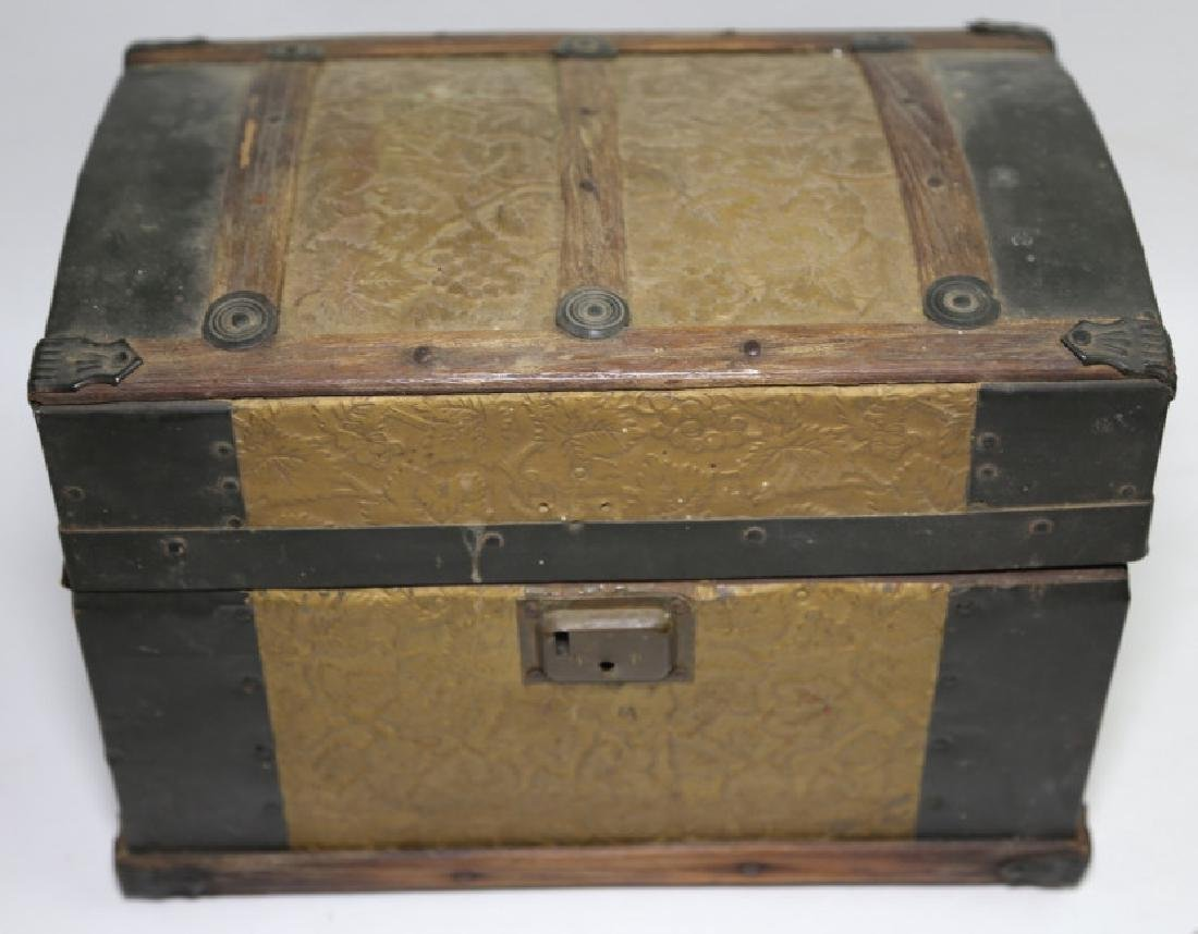 ANTIQUE DOME TOP CHILDS TRUNK WITH DOLL CLOTHES