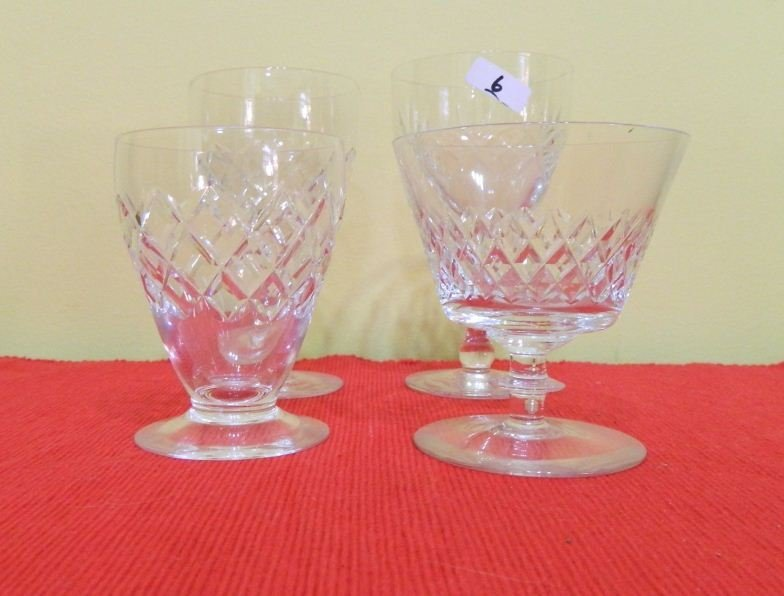 6: Four small crystal glasses various patterns and shap