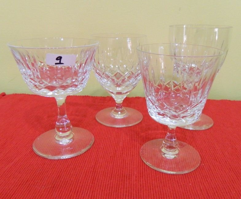9: Four cut crystal glasses various patterns and shapes