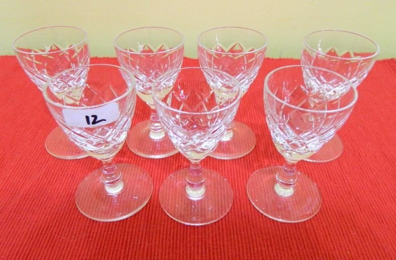 12: Seven small cut crystal glasses