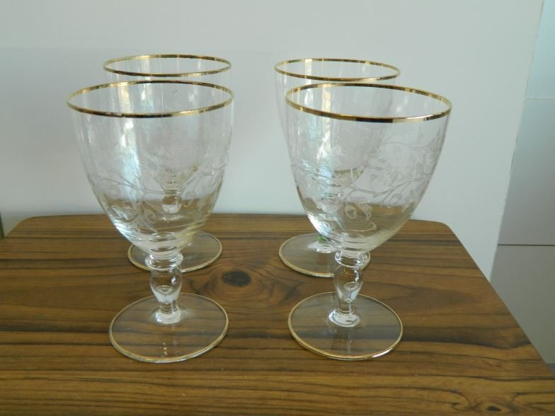 Four gilded and etched wine glasses