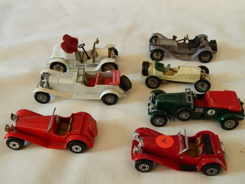 Four Models of Yesteryear and three matchbox model cars