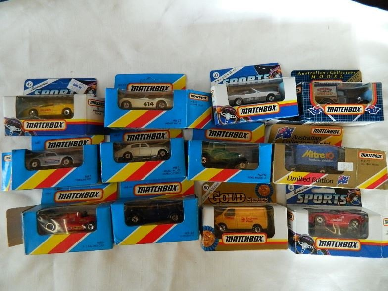 Twelve Matchbox model cars, trucks and vans