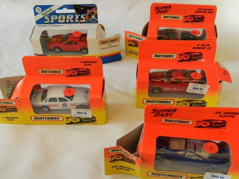 Five Matchbox model cars