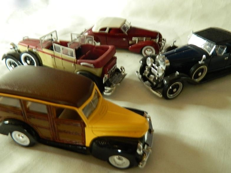 Four model cars