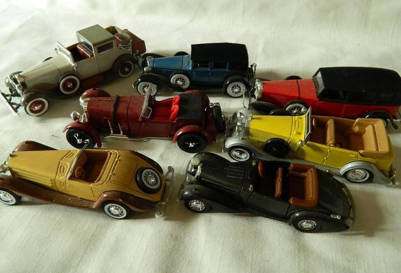 Seven scale model cars