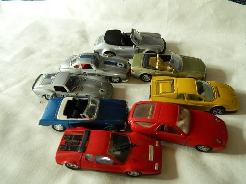 Eight model cars