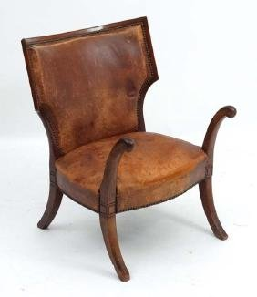 A 19 th C Military Officers leather ' Sword ' chair (