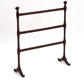 A charming 19thC mahogany painted child's towel rail