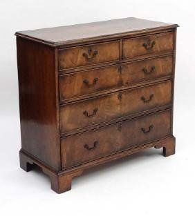 A C.1900 walnut chest of drawers comprising two short