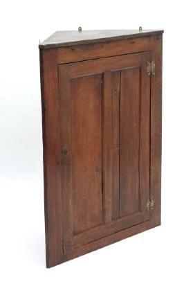 An early 19thC oak panelled corner cupboard 41'' high