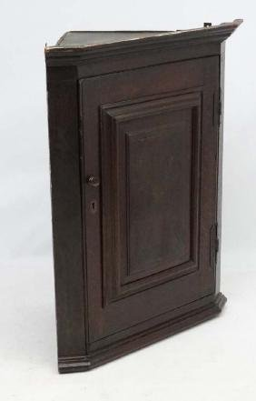A 19thC oak hanging corner cupboard with parquetry