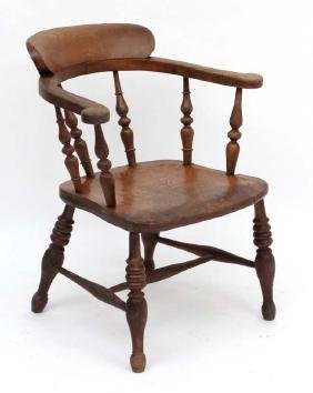 A 19thC elm seated Smokers Bow chair 30 3/4'' high
