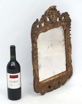 An 18thC Continental carved wooden wall mirror with