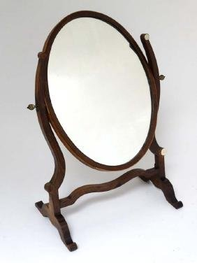 A 19thC mahogany oval skeleton mirror. Approx 22'' high