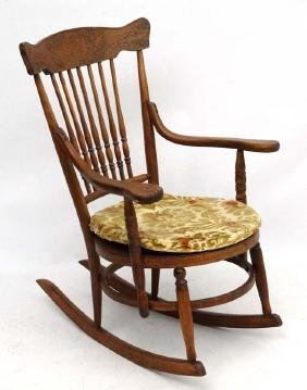 An American oak and bentwood circular seated rocking